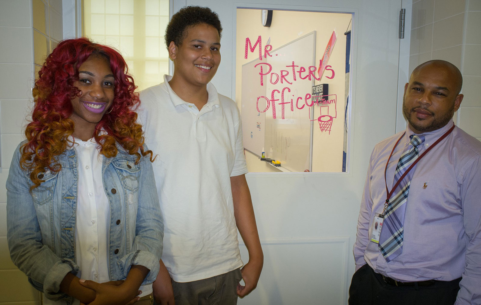 An amazing guidance counselor at Anacostia High with two of his students.
