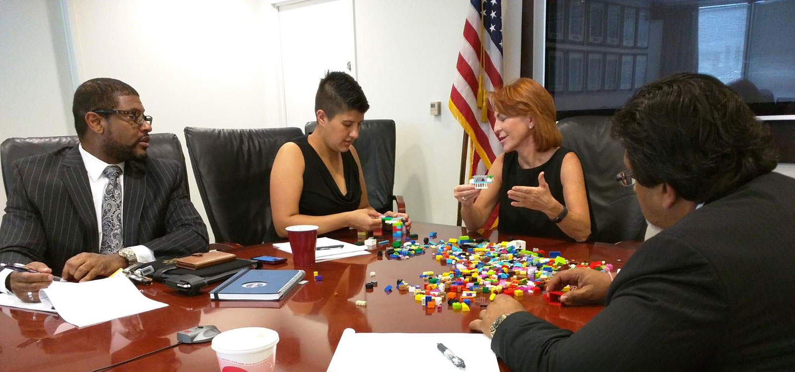 SBA executives prepare to build with Legos.