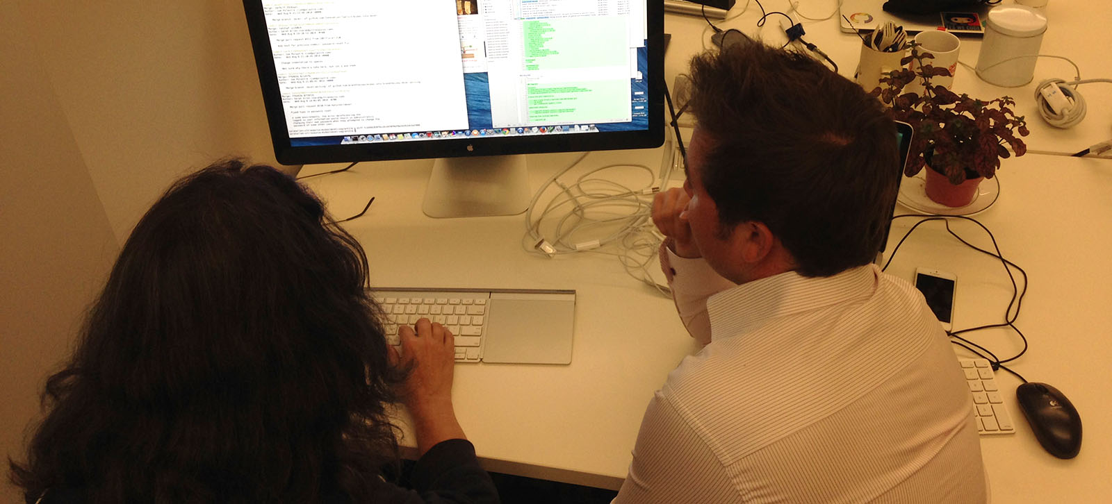 Two developers coding together