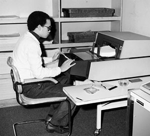 FEC staff scanning compliance forms, 1982